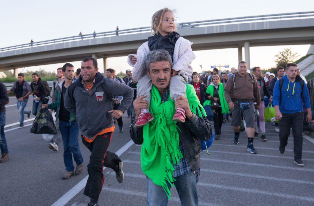 Migrants walking along a motorway near the southern Hungarian village of Roszke, Sept. 7, 2015. (Matt Cardy/Getty Images)