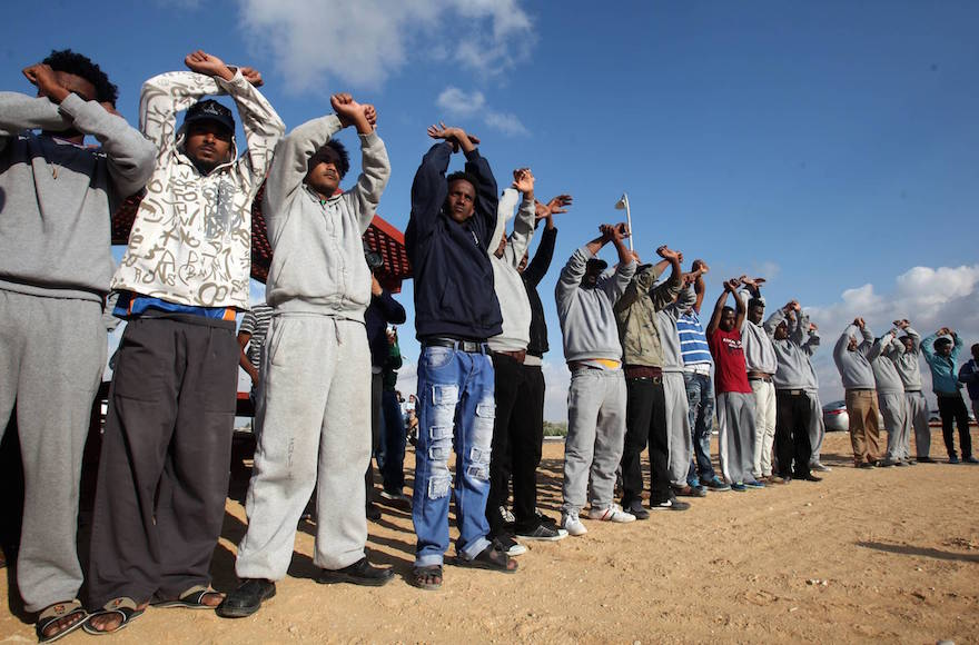 African migrants protesting outside the Holot detention center near Ktsiot, in the Negev Desert, southern Israel on February 17, 2014. (Flash90)