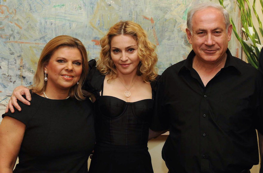 Madonna, center, with Israel Prime Minister Benjamin Netanyahu, right, and his wife Sara Netanyahu, left, at the Prime Minister's residence in Jerusalem on Sept. 4, 2009. (Avi Ohayon/GPO via Getty Images)