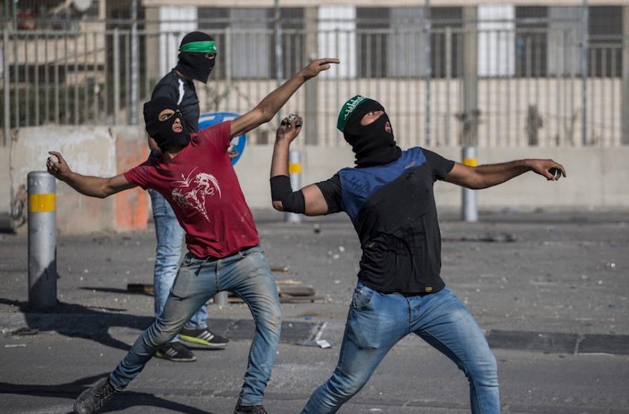 Palestinians throwing rocks at Israeli police during clashes in eastern Jerusalem, Sept. 18, 2015. (Hadas Parush/Flash90)