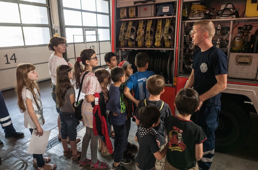 Refugee children visiting a fire department in Berlin. (Judith Kessler)