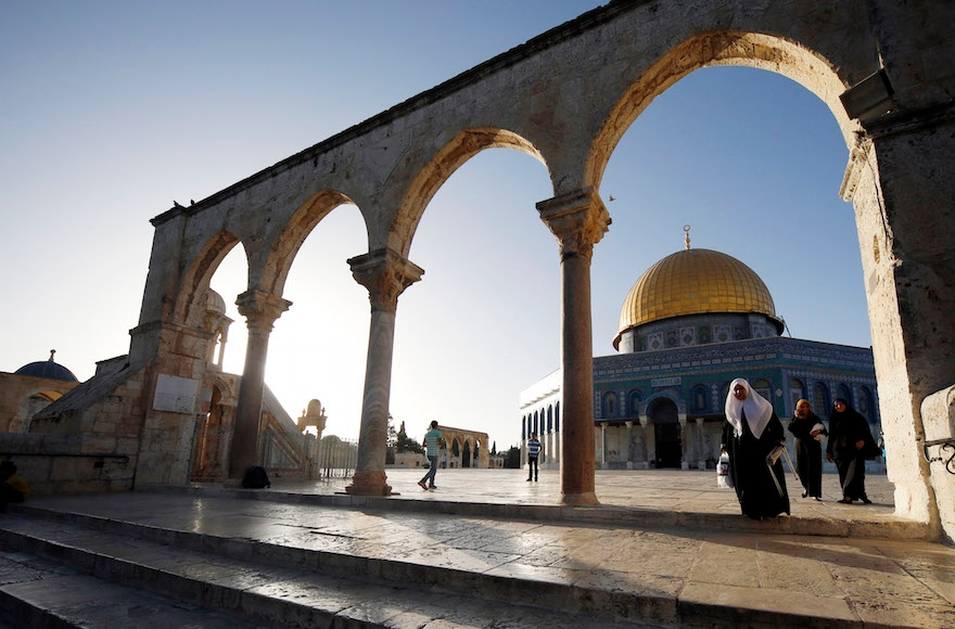 Muslims walking by the Al-Aqsa Mosque, in Jerusalem's Old City, on their way to pray on the second day of the holy Muslim month of Ramadan, Jun 30 2014. (Sliman Khader/Flash90)