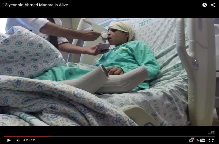 Israel releases a video of Ahmed Mansra, 13, eating in his hospital bed at Hadassah Hospital after Palestinian Authority President Mahmoud Abbas accused Israel of 'executing' him. (Courtesy GPO)