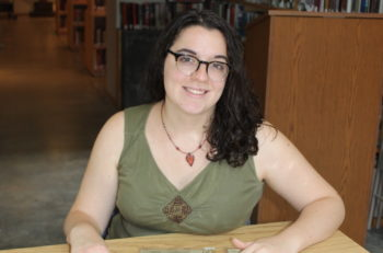 Marissa Natale is researching a new collection of Holocaust money for Clark University and considering how students may be able to use it. (Courtesy of Clark University)