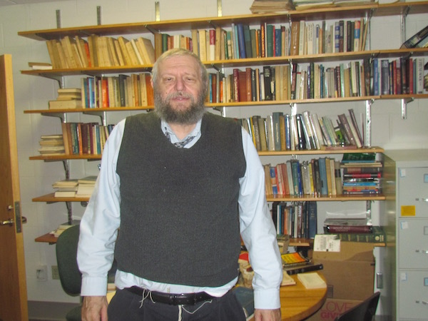 Richard Sugarman, a professor of Jewish philosophy, in his University of Vermont office, Oct. 15, 2015. (Ron Kampeas)
