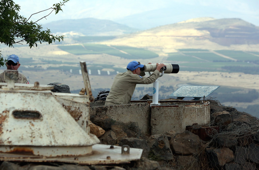 A UN observer atop Mount Bental on the Israeli side of the border with Syria, close to the city of Quneitra, on May 30, 2015. (Yossi Zamir/Flash90)