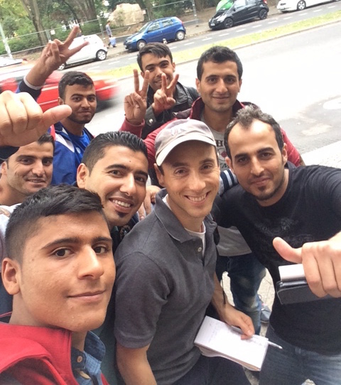 Some of the Syrian refugees interviewed in Berlin insisted on taking selfies with JTA's Uriel Heilman, in Yankees cap. (Uriel Heilman)