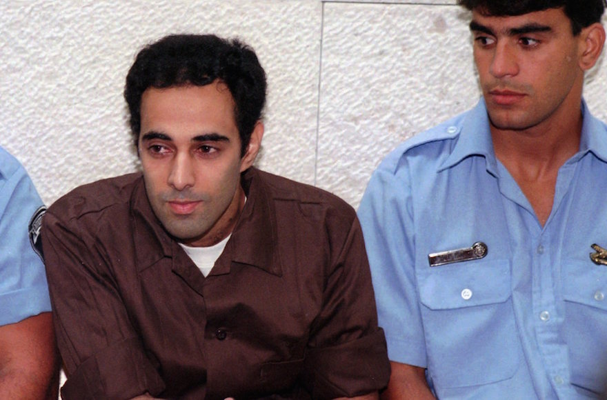 Yigal Amir, convicted for the murder of Israeli Prime Minister Yitzhak Rabin is flanked by two prison warders at the first hearing of his appeal to the Israeli Supreme Court in Jerusalem, July 7 1996. (Eyal Warshavsky/AP Images)