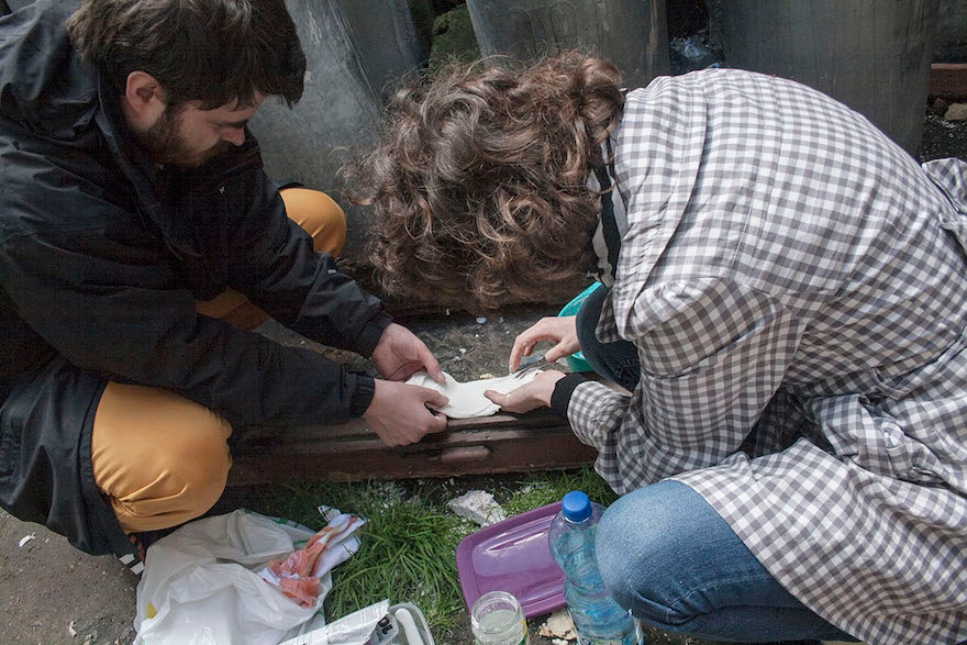 Helena Czernek and Aleksander Prugar making a plaster cast from the impression left by a mezuzah. (Katarzyna Markusz)