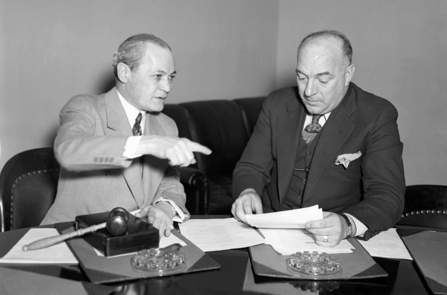 Chairman Samuel Dickstein, left, of the House Immigration Committee, discussing the bill of Rep. William Schulte, D-Ind., to restrict immigration into the United States from Mexico, March 7, 1934. (AP Images)