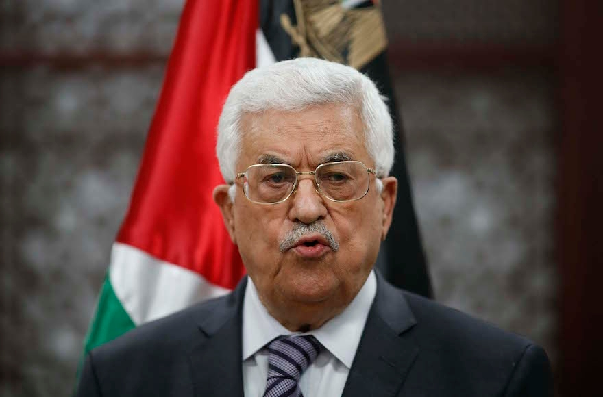 Palestinian president Mahmoud Abbas speaking at a press conference in the West Bank city of Ramallah after the arson attack by Jewish extremists that killed a Palestinian toddler, July 31, 2015. (Flash90)