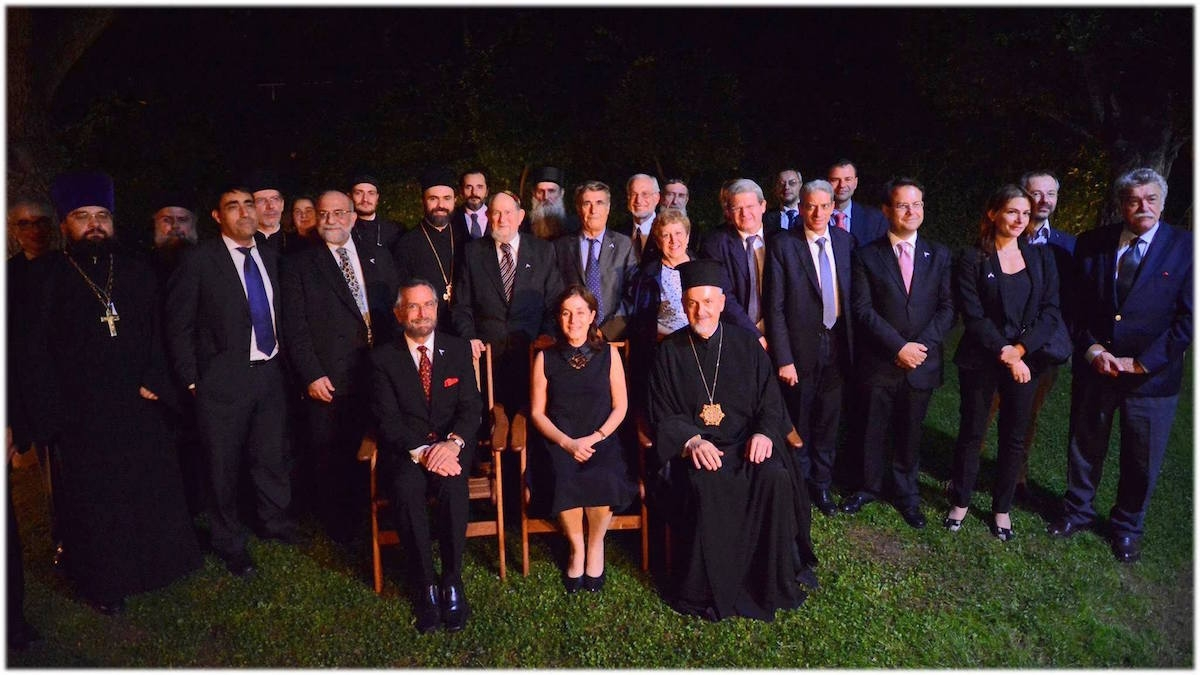 Jewish and Orthodox Christian clerics and scholars posing with the Israeli ambassador to Greece, Irit Ben-Abba, at an interfaith dialogue commemorating 25 years of formal relations between Israel and Greece. (Embassy of Israel in Athens)