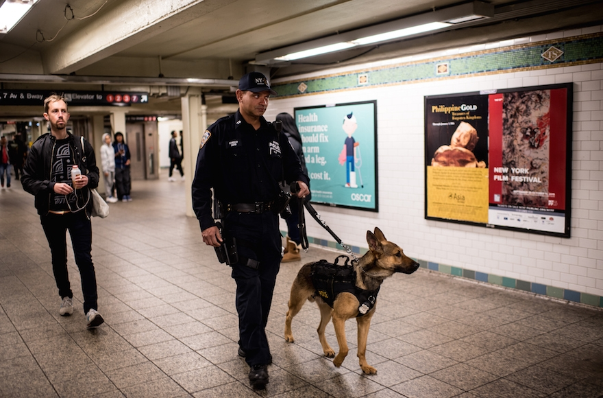A police officer patrolling the Times Square subway stop in New York City the day after a series of terrorist attacks occurred in Paris, Nov. 14, 2015. (Andrew Renneisen/Getty Images)