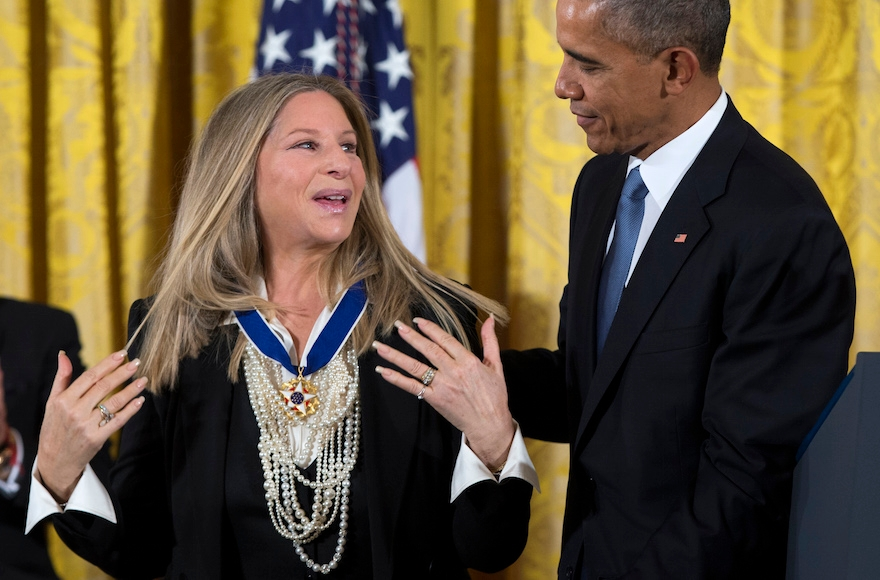 President Barack Obama, right, presenting the Presidential Medal of Freedom to Barbra Streisand during a ceremony in the East Room of the White House in Washington, D.C., Nov. 24, 2015. (Evan Vucci/AP Images)
