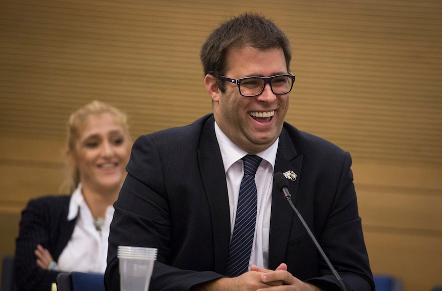 Israeli lawmaker Oren Hazan laughing at a Knesset committee meeting in Jerusalem, Oct. 26, 2015. (Hadas Parush/Flash90)