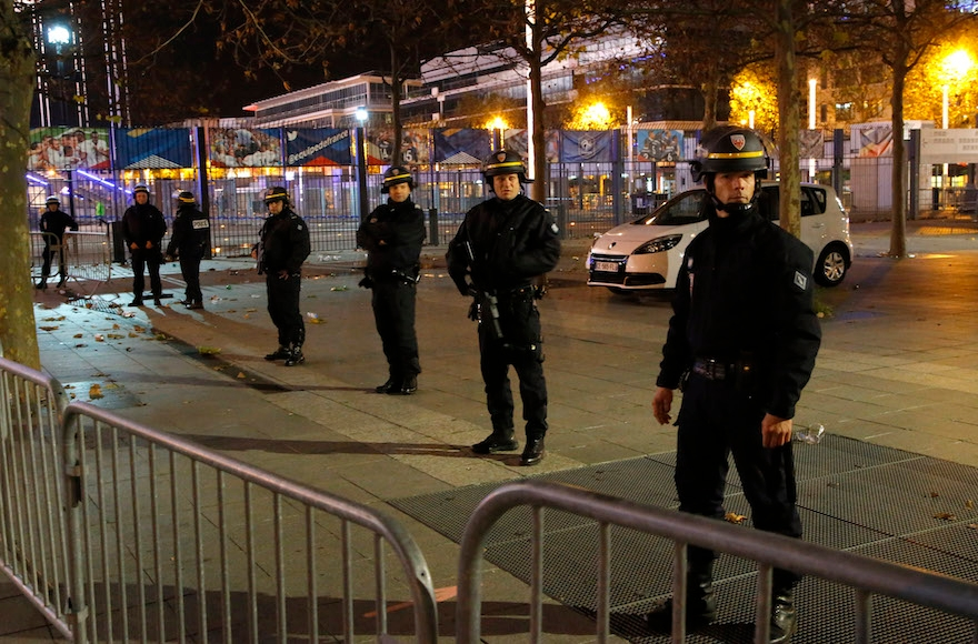 Police officers securing the Stade de France stadium during the soccer match between France and Germany in Saint Denis, outside Paris, Nov. 13, 2015. (Michel Euler/AP Images)