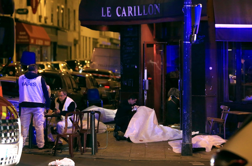 Victims lying on the pavement outside a Paris restaurant, Nov. 13, 2015. (Thibault Camus/AP Images)