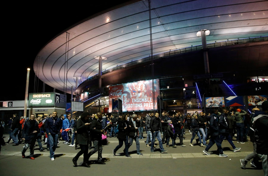People leaving the Stade de France stadium after the soccer match between France and Germany in Saint Denis, outside Paris, Nov. 13, 2015 (Michel Euler/AP Images)