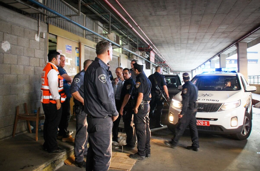 Israeli police at the scene where two Israelis were killed and at least two others wounded in a stabbing attack in southern Tel Aviv, Nov. 19, 2015. (Moti Karelitz/ZAKA Tel Aviv)