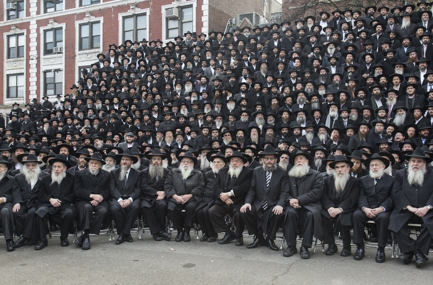 Thousands of rabbis posing for a group photo in front of Chabad-Lubavitch world headquarters in the Brooklyn borough of New York, Nov. 23, 2014. (Adam Ben Cohen/Chabad.org)