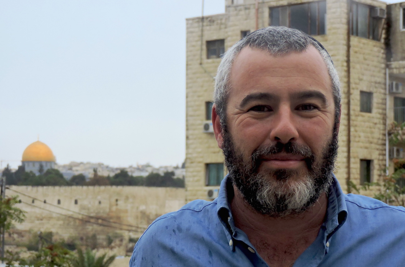 Yishai Fleisher moved with his family to a Jewish enclave inside the Arab neighborhood of Ras al-Amud, adjacent to the Mount of Olives. (Ben Sales)