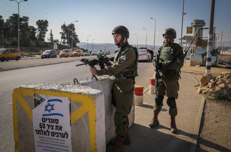 Israeli soldiers guarding a barrier at the Gush Etzion junction, Nov. 23, 2015. (Gershon Elinson/FLASH90)