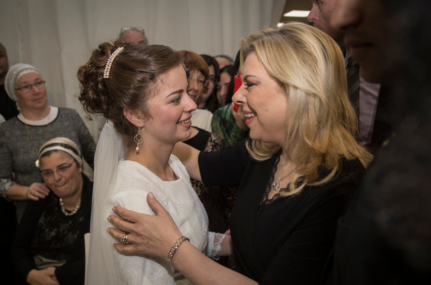 Sara Netanyahu, the wife of Israeli Prime Minister Benjamin Netanyahu, celebrating with Sarah Litman at her wedding in Jerusalem, Nov. 26, 2015. (Hadas Parush/Flash90)