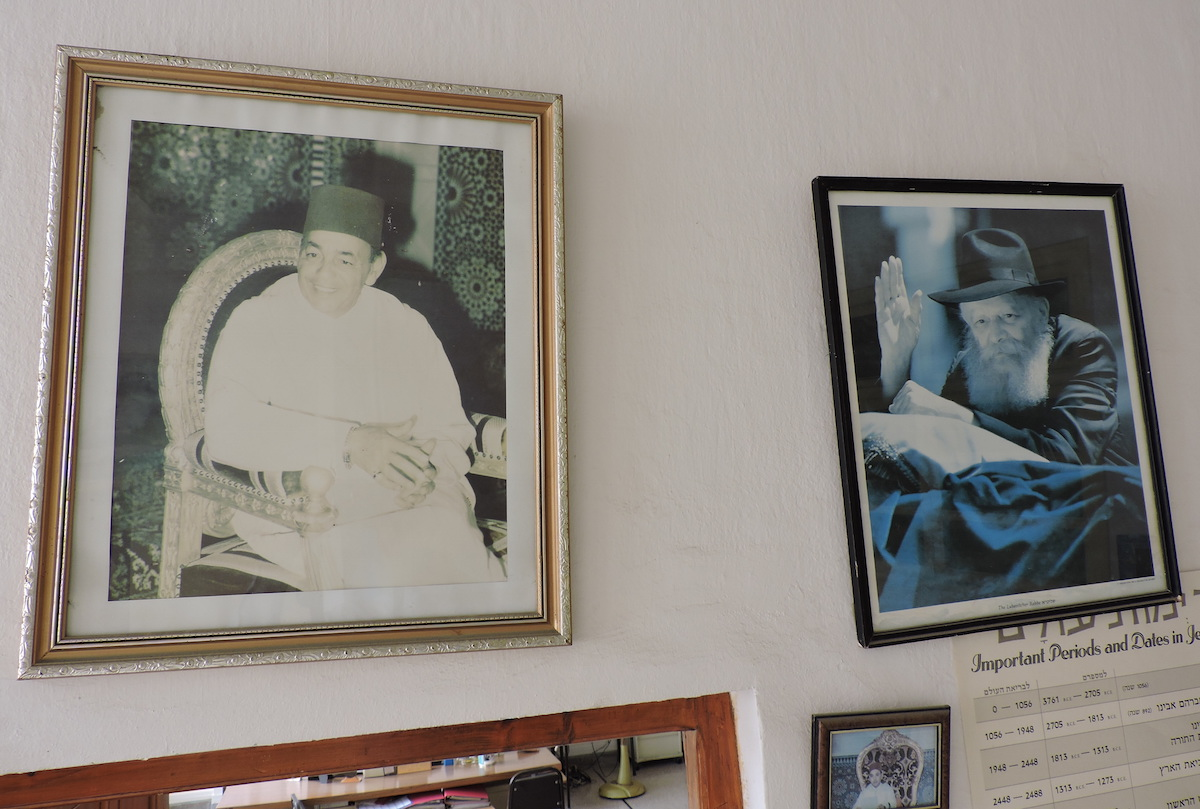 Photos of King Hassan II and Rabbi Menachem Mendel Schneerson adorn the wall of the Chabad facility in Casablanca. (Ben Sales)