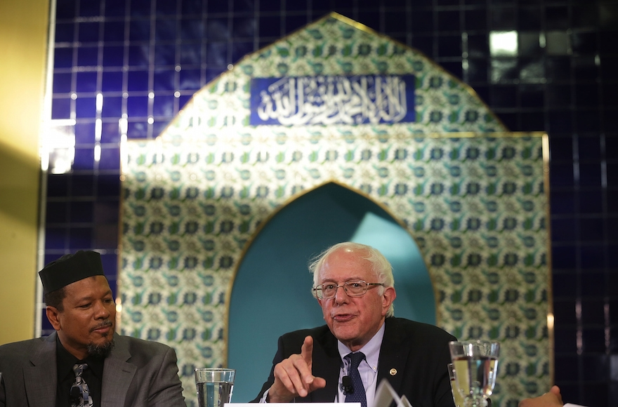 Democratic presidential candidate Sen. Bernie Sanders, I-Vt, right, speaking as Imam Talib Shareet listens at Masjid Muhammad, The Nation's Mosque, in Washington, D.C., Dec. 16, 2015. (Alex Wong/Getty Images)