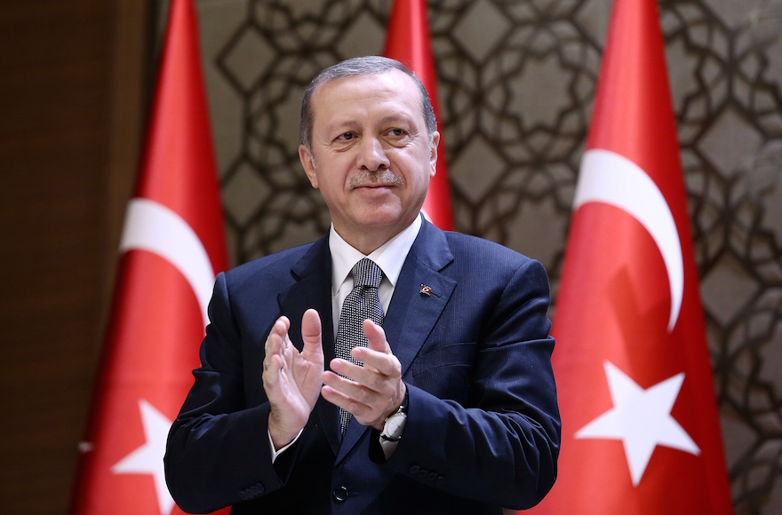 Turkish President Recep Tayyip Erdogan clapping during the 2015 Turkish Academy of Sciences award ceremony at Presidential Complex in Ankara, Turkey, Dec. 14, 2015. (Yasin Bulbul/Presidency/Anadolu Agency/Getty Images)