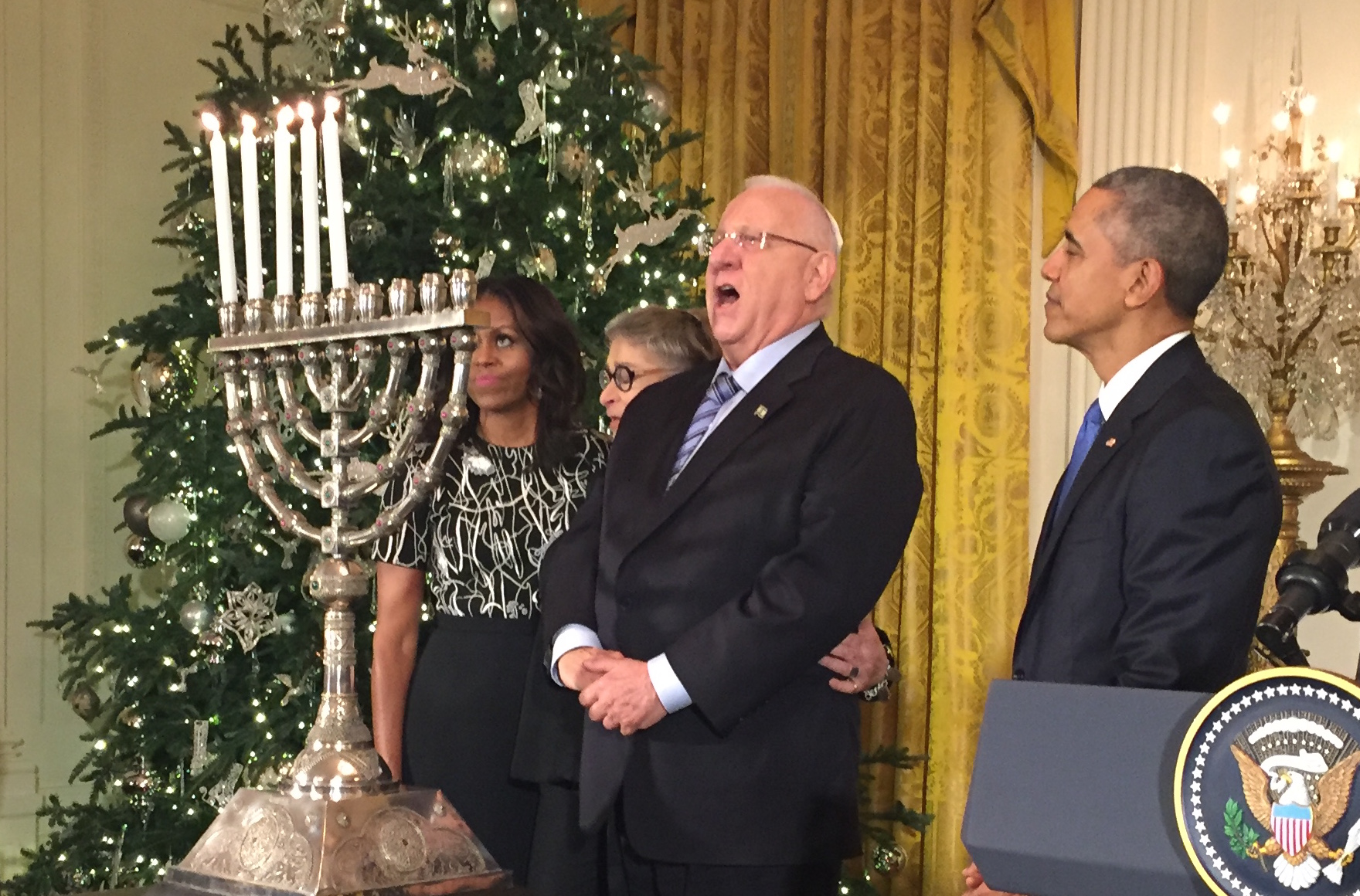Israeli President Reuven Rivlin singing Maoz Tsur at a White House Hanukkah party while President Barack Obama and Rabbi Susan Talve of St. Louis look on, Dec. 9, 2015. (Steve Sheffey)
