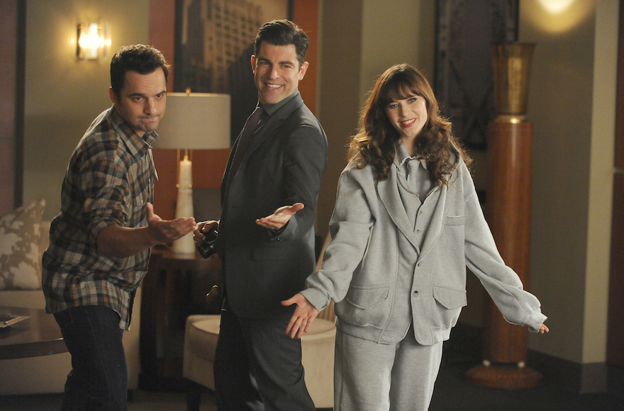"Schmidt (Max Greenfield), center, Nick (Jake Johnson), left, and Jess (Zooey Deschanel) in a scene from ""New Girl,"" Feb. 3, 2015. (FOX via Getty Images)"