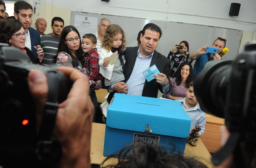 Ayman Odeh casting his vote at a ballots station in Nazareth, Israel on election day, March 17, 2015. (Basal Awidat/Flash90)