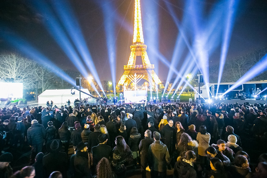 Thousands participating in Chabad-Lubavitch's annual public menorah lighting ceremony at the base of the Eiffel Tower in Paris, Dec. 6, 2015. (Chabad.org/Thierry Guez)