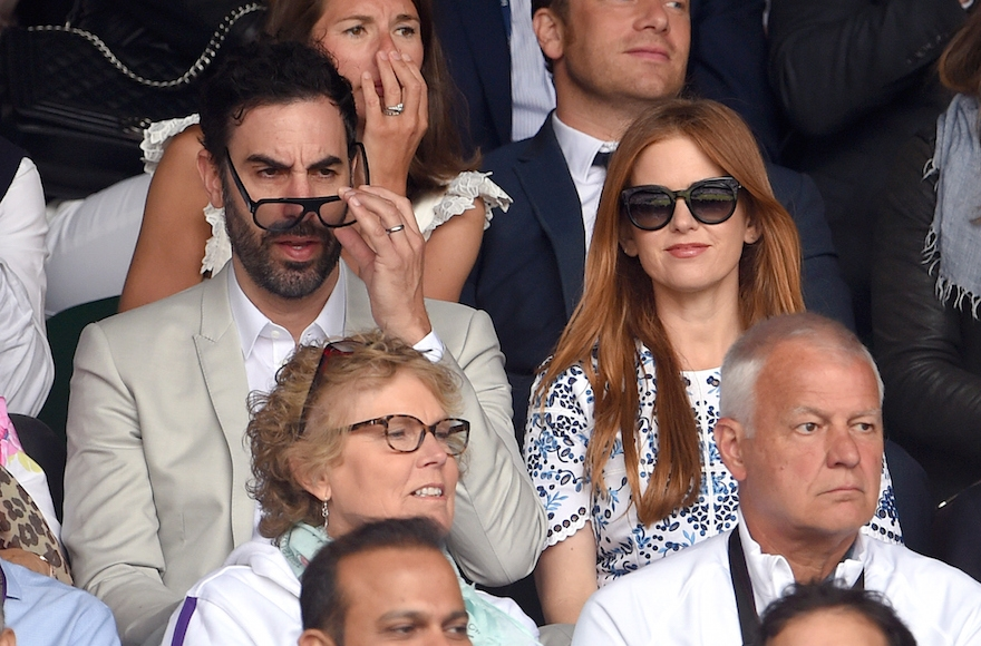 Sacha Baron Cohen and Isla Fisher attending day 13 of the Wimbledon Tennis Championships at Wimbledon in London, July 12, 2015.  (Karwai Tang/WireImage)
