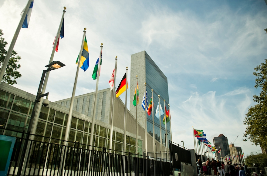 Flags of member nations flying in front of United Nations headquarters n New York, Sept. 25, 2015. (Michael Gottschalk/Photothek via Getty Images)