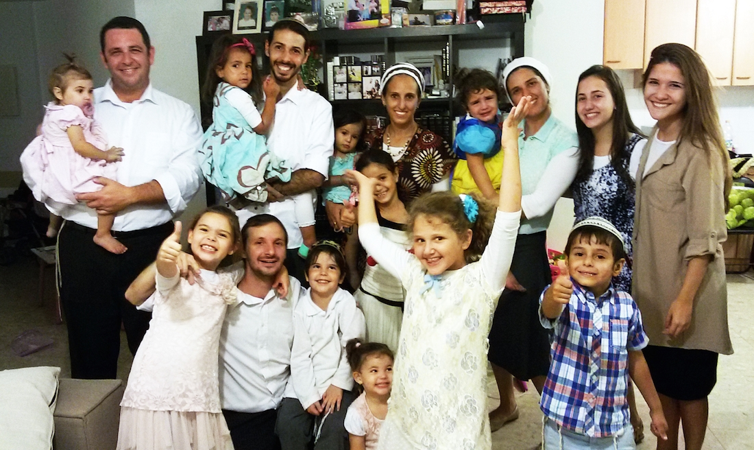 Brazilian immigrant Fabio Erlich, far left, with his family and other Brazilian emigres in the Israeli city of Modiin. (Courtesy of Erlich family)