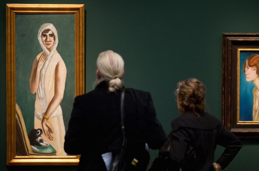 "Visitors looing at Max Beckmann's ""Portrait Quappi Beckmann"" from 1925 during the preview of the exhibition ""Dix/Beckmann - Mythos Welt"" at Hypo-Kunsthalle in Munich, Germany, April 10, 2014. (Joerg Koch/Getty Images)"
