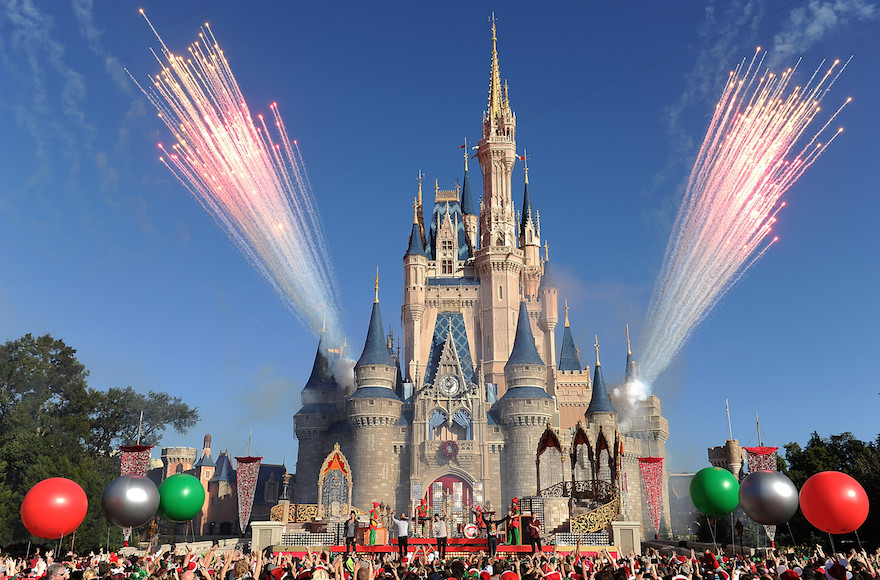 Concert goers cheering at the Magic Kingdom park at Walt Disney World Resort in Lake Buena Vista, Florida, Dec. 6, 2013. (Mark Ashman/Disney Parks via Getty Images)
