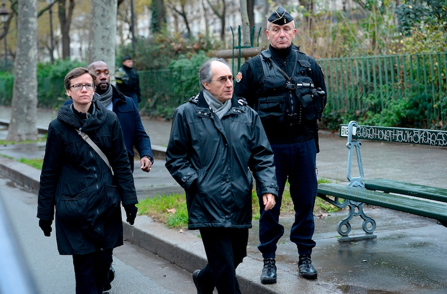 Gerard Biard, center, editor in chief of Charlie Hebdo, arriving to the inauguration of the memorial stone in front of the former Charlie Hebdo office in Paris, Jan. 5, 2016. (Aurelien Meunier/Getty Images)