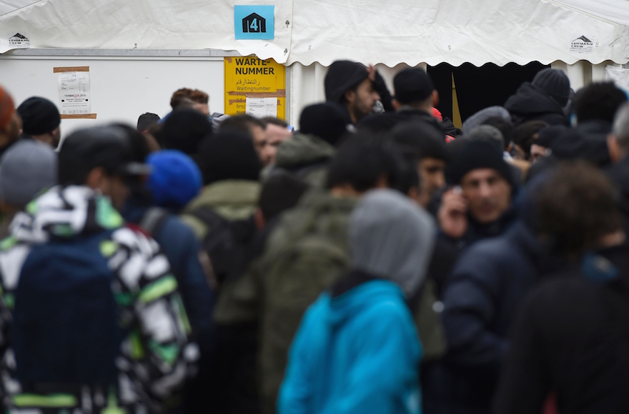 Migrants queuing next to a tent at the State Office of Health and Social Affairs in Berlin, Germany, Jan. 27, 2016. (Tobias Schwarz/AFP/Getty Images)