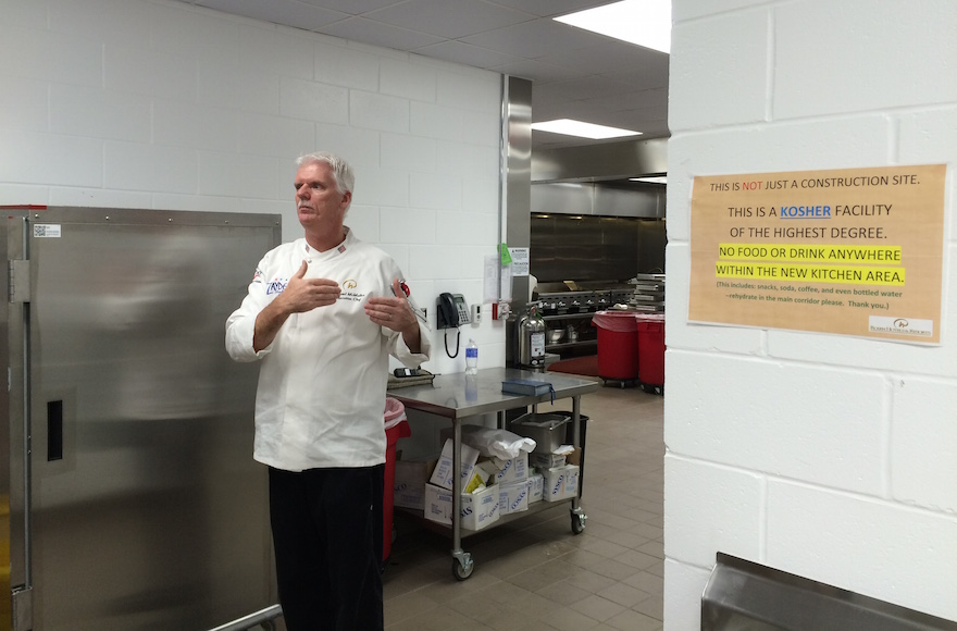 Executive Chef Michael McMullen of the Rosen Plaza explains the special kosher safeguards at the hotel's new $2 million kosher kitchen. (Uriel Heilman)