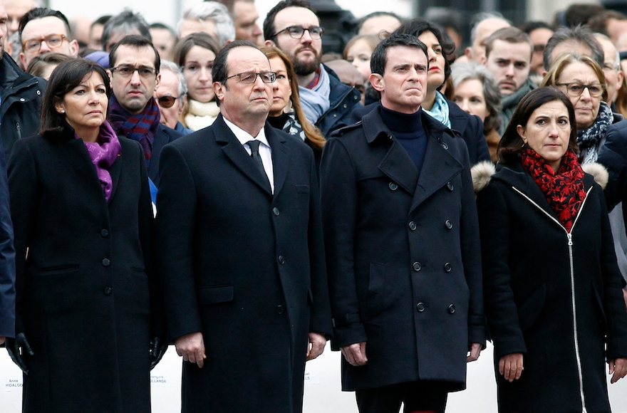 Prime Minister Manuel Valls, third from left. paying respect during a ceremony held for the victims of terrorist attacks at Place de la Republique in Paris, France, Jan, 10, 2016.. (Thierry Chesnot/Getty Images)