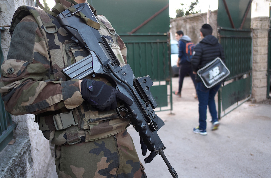An armed French soldier securing the access to the La Source Jewish school in Marseille, southern France a day after a teenager, armed with a machete and a knife, wounded a teacher slightly before being stopped and arrested, Jan. 12, 2016. (Boris Horvat/AFP/Getty Images)