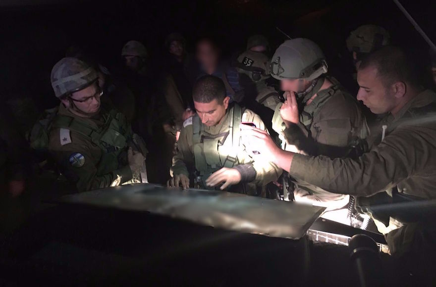 Israeli security forces searching at the scene of a fatal stabbing of a Jewish woman in her 30s in the West Bank settlement of Otniel. (IDF Spokesperson/Flash90)