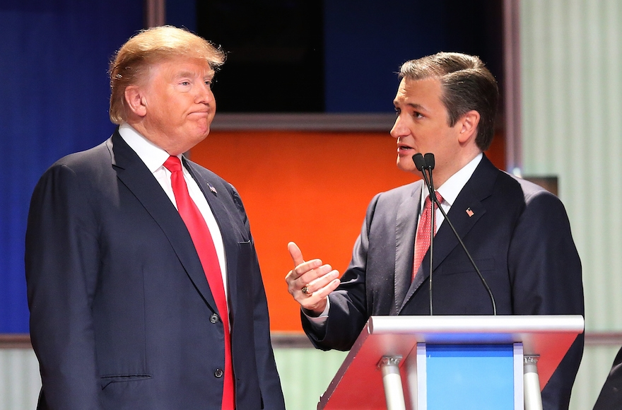 Republican presidential candidates Donald Trump, left, and Sen. Ted Cruz, R-Tx., speaking during a commercial break in the Fox Business Network Republican presidential debate in North Charleston, South Carolina, Jan. 14, 2016. (Scott Olson/Getty Images)
