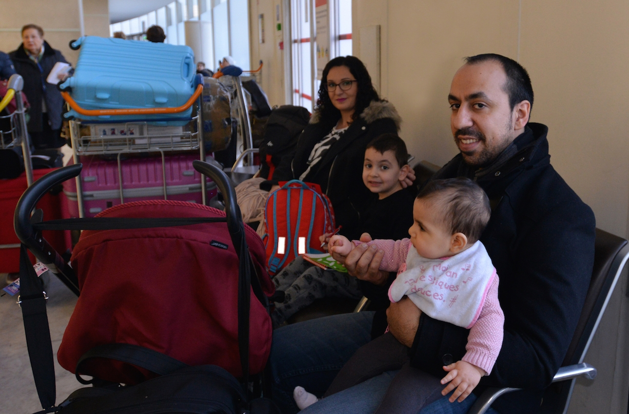 Rudy Abecassis and his family at Charles de Gaulle Airport preparing to fly to Israel, Dec. 27, 2015. (Cnaan Liphshiz)