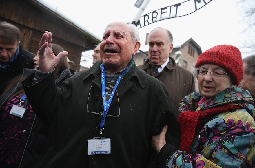 Mordechai Ronen, who was a prisoner at the Auschwitz concentration camp when he was an 11-year-old child and lost his mother, father and sisters there, breaking into tears as he walks through the camp, which is now a museum in Oswiecim, Poland, Jan. 26, 2015. (Sean Gallup/Getty Images)