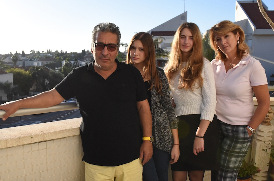 Catherine Berdah, right, with her husband and daughters in their apartment in Ra'anana, Israel. (Cnaan Liphshiz)
