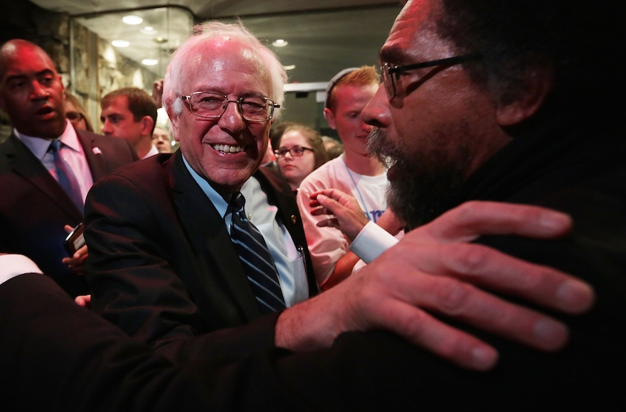 Philosopher Cornel West, right, embracing Democratic presidential candidate  Bernie Sanders in Des Moines, Iowa, Nov. 14, 2015. (Photo by Alex Wong/Getty Images)